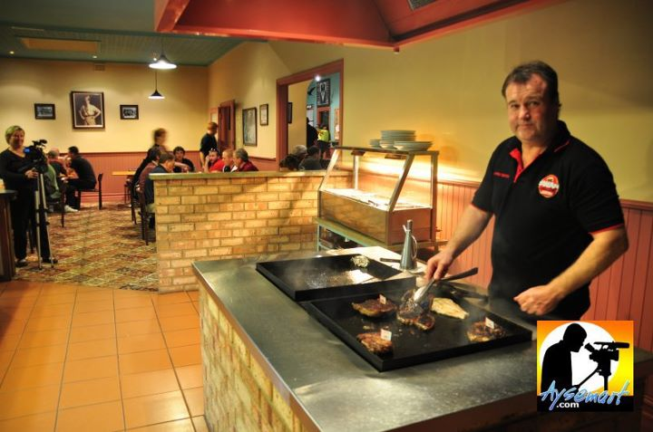 Brett grilling steak at Jennacubbine Tavern, Goomalling