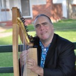 Local musician/composer/producer Adam B Harris playing harp